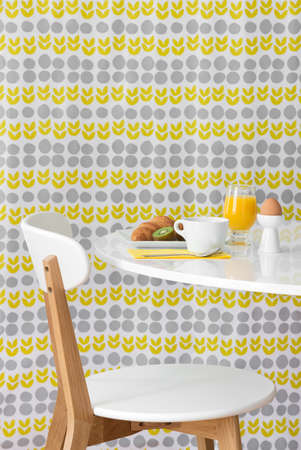 Breakfast  Modern table and chair on bright floral background  Stockfoto