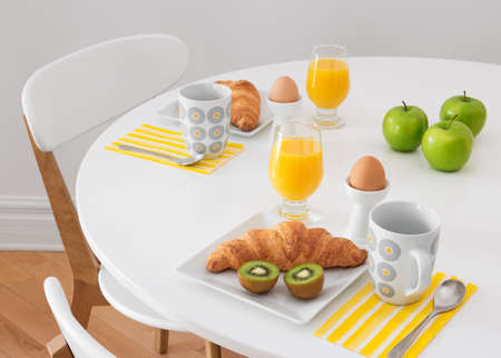 round chairs: White round table with simple healthy breakfast  Stock Photo