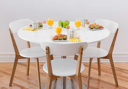 세 건강한 아침 식사와 함께 흰색 라운드 테이블