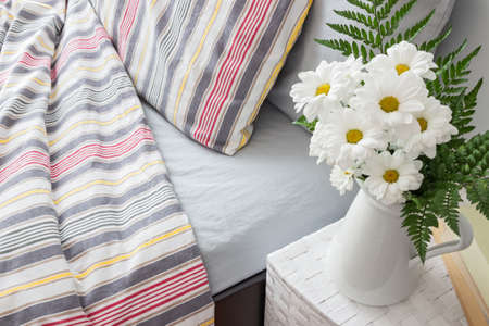 material flower: Bright bedroom decorated with a bouquet of white flowers