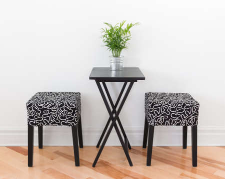 table: Table for two decorated with green plant  Simple design