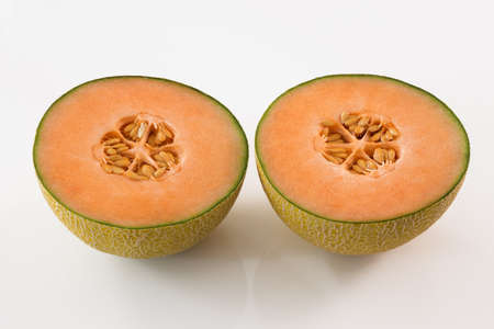 two and a half: Tasty sweet melon cut in two, on white background