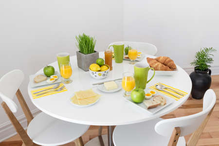 table: White round table with tasty and healthy breakfast  Stock Photo