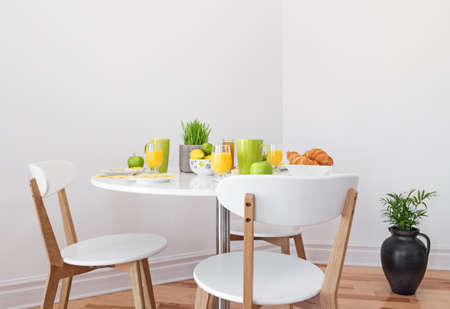 Tasty and healthy breakfast on a white round table  photo