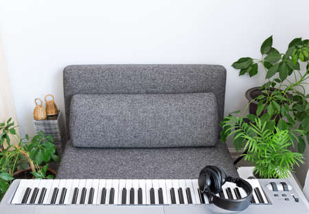 Electric piano and comfortable armchair for a musician. photo