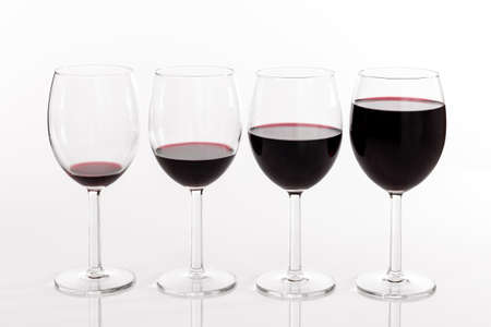 Four glasses filled with different quantities of red wine
