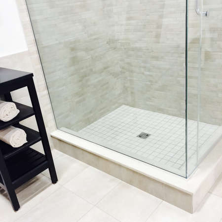 New modern bathroom with shower and ceramic floor