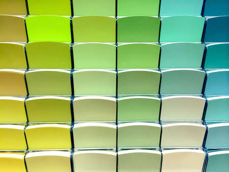 Green color swatches in a store, to choose the right paint.