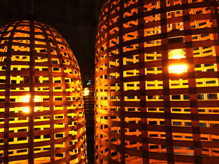 Lamps with wicker lampshades, cozy lighting.