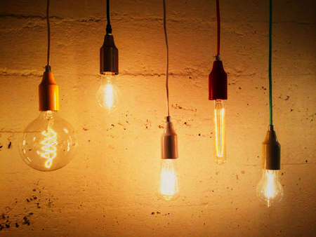 Light bulbs decorating a concrete wall. Contemporary design.
