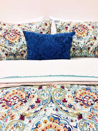 Close-up of a bed. Colorful bed linen with floral design.