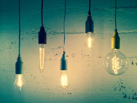 Illuminated light bulbs on green background. Industrial design.