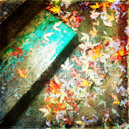 Grungy background with autumn leaves and stone steps.