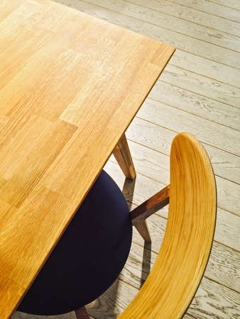 Wooden table and stylish chair, mid century modern style.