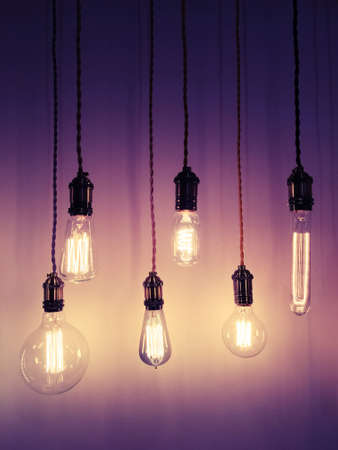 Industrial style light bulbs on purple background. Modern design with retro feel.