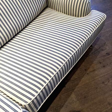 Elegant Blue And White Striped Sofa On Dark Wooden Floor. Stock Photo    61245778
