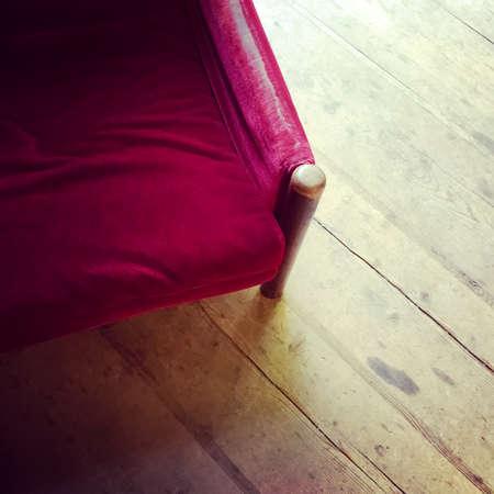 Stock Photo   Vintage Red Velvet Armchair On Wooden Floor. Retry Style  Furniture.