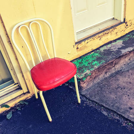 Bright Chair Outside The House. Old Building Exterior. Stock Photo    77743432