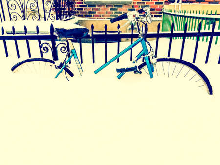 Bicycle in snow, after snowstorm, near an urban building. Retro style photo. Stock Photo