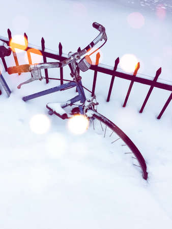 Bicycle in snow, after snowstorm. Bokeh light effect.