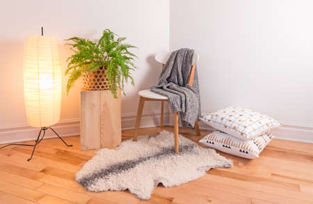 Room with cozy light decorated in Scandinavian style, using natural materials.