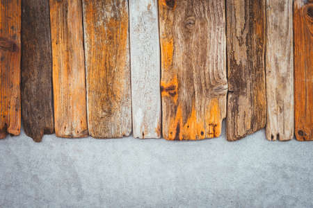 Vintage wooden planks on concrete background. Driftwood and cement texture.