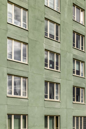 Windows of a green residential building. Stockholm, Sweden.