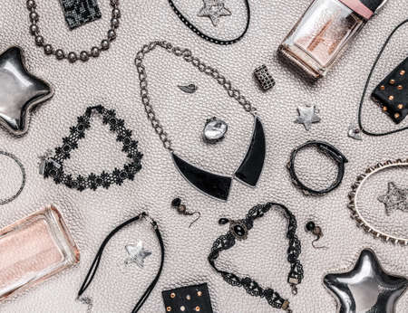 Rock, gothic and punk style jewelry. Lace and metal necklaces, earrings, rings, star-shaped black storage box. Standard-Bild - 141304509