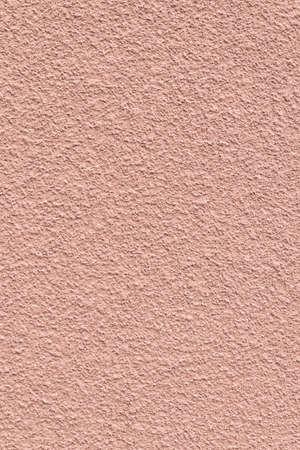 Textured pink wall of an urban building. Standard-Bild - 141304650