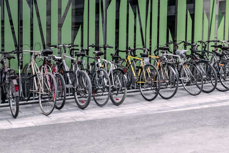 Bicycles near a green wall. Eco-friendly transportation. Montreal (Quebec, Canada). Standard-Bild