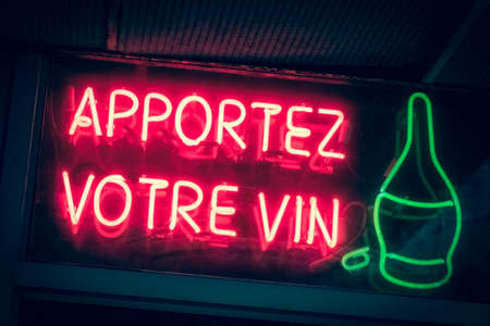 Apportez votre vin. Bring your own wine. Restaurant neon sign in French language.