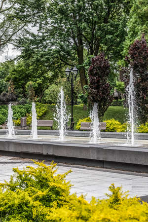 Spring city park with fountains and green trees. Montreal (Quebec, Canada). Standard-Bild
