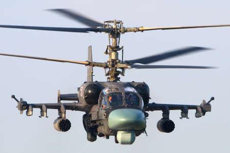 avia: Stock Photo - KUBINKA, RUSSIA - JULY 14, 2015: Kamov Ka-52 Alligator, combat helicopter takes off at Kubinka air force base, Russia Editorial