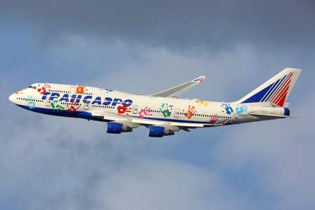 avia: Stock Photo - VNUKOVO, RUSSIA - AUGUST 13, 2015: Boeing 747 of Transaero airlines landing in Vnukovo international airport, Russia Editorial
