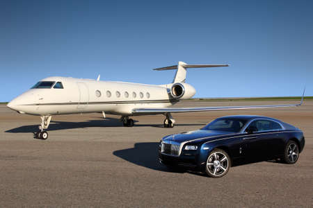 wraith: Stock Photo - SHEREMETYEVO, RUSSIA - APRIL 24 2015: Gulfstream G550 and Rolls Royce Wraith in Sheremetyevo international airport, Russia Editorial