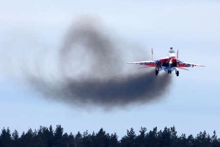 aerobatic: KUBINKA, MOSCOW REGION, RUSSIA - FEBRUARY 24, 2014: MiG-29UB jet fighter performing go around exercise at Kubinka air force base.