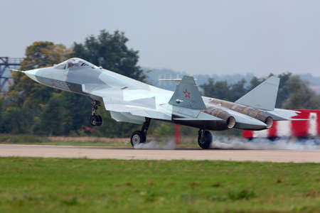ZHUKOVSKY, MOSCOW REGION, RUSSIA - AUGUST 30, 2013: Sukhoi T-50 PAK-FA prototype is a brand new fifth generation jet fighter shown while performing demonstartion flight in Zhukovsky during maks-2013. Editorial