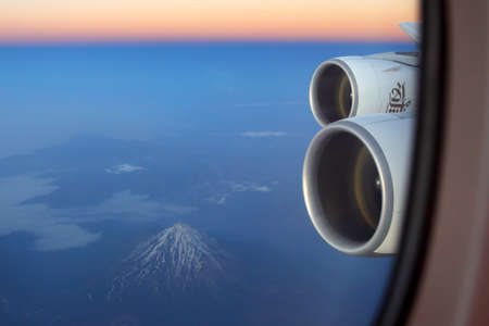 IRAN - JUNE 25, 2014: Emirates Airbus A380 wing view (Damavand volcano seen).