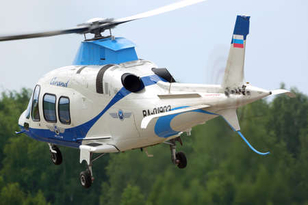 VLADIMIR, RUSSIA - JUNE 2, 2015: Private Agusta A109S Grand helicopter RA-01903 departing Semyazino airfiled. Editorial