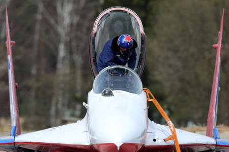KUBINKA, MOSCOW REGION, RUSSIA - APRIL 21, 2017: Pilot of Mikoyan-Gurevich MiG-29 of Swifts aerobatics team of Russian air force during Victory Day parade rehearsal at Kubinka air force base. Editorial