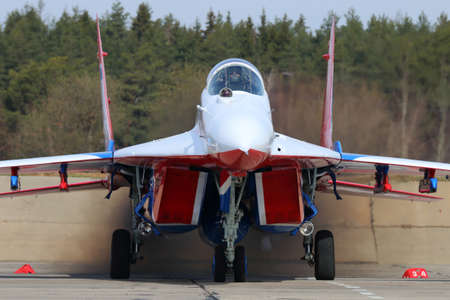 aerobatics: KUBINKA, MOSCOW REGION, RUSSIA - APRIL 21, 2017: Mikoyan-Gurevich MiG-29 of Swifts aerobatics team of Russian air force during Victory Day parade rehearsal at Kubinka air force base. Editorial