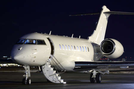 Business jet airplane at night.