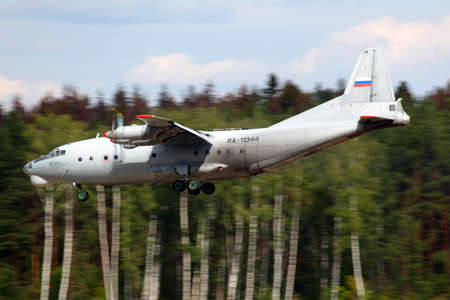 CHKALOVSKY, MOSCOW REGION, RUSSIA - AUGUST 26, 2011: Antonov An-12 RA-11344 of Russian Air Force landing at Chkalovsky.