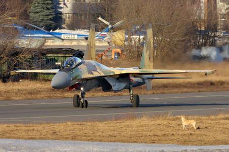 Zhukovsky, Moscow Region, Russia - March 13, 2014: Sukhoi Su-35BM 901 BLACK performing test flight in Zhukovsky. Editorial