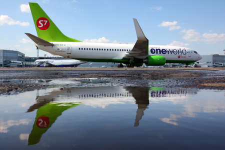 Domodedovo, Moscow Region, Russia - August 2 2011: S7 airlines Boeing 737-800 VQ-BKW in One World alliance livery shown at Domodedovo international airport.