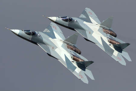 Zhukovsky, Moscow Region, Russia - August 24, 2013: Pair of Sukhoi T-50 PAK-FA 052 BLUE and 051 BLUE modern russian jet fighters performing demonstration flight in Zhukovsky during MAKS-2013 airshow. Editorial
