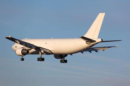 civil cargo airplane landing in airport. Reklamní fotografie