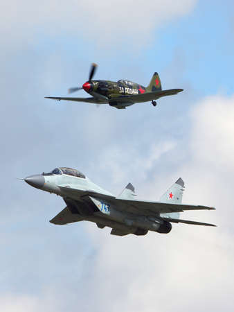 Zhukovsky, Moscow Region, Russia - August 29, 2015: Mikoyan MiG-35 and MiG-3 jet fighters perfoming demonstration flight in Zhukovsky during MAKS-2015 airshow.