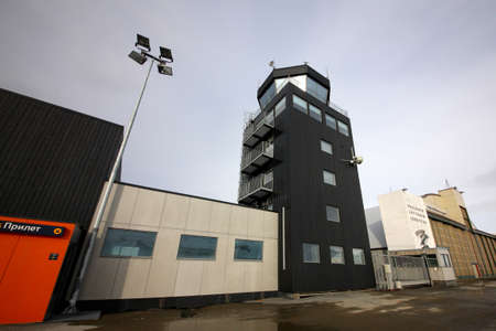 Longyearbyen, Svalbard, Norvay - April 24, 2013: Tower and terminal of Svalbard airport.