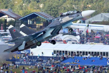 Zhukovsky, Moscow Region, Russia - August 30, 2015: Sukhoi Su-30SM 38 BLACK of russian navy perfoming demonstration flight in Zhukovsky during MAKS-2015 airshow. Redakční